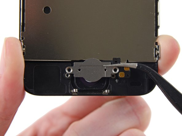 Image 1/1: If you're installing a new home button ribbon cable, be sure to keep the metal bracket and transfer it to your new ribbon cable during reassembly.