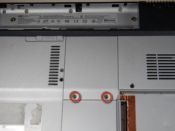 Locate the two screws holding down the RAM access cover