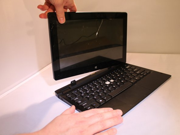Image 2/3: Place the device on a firm surface with the device screen facing down.