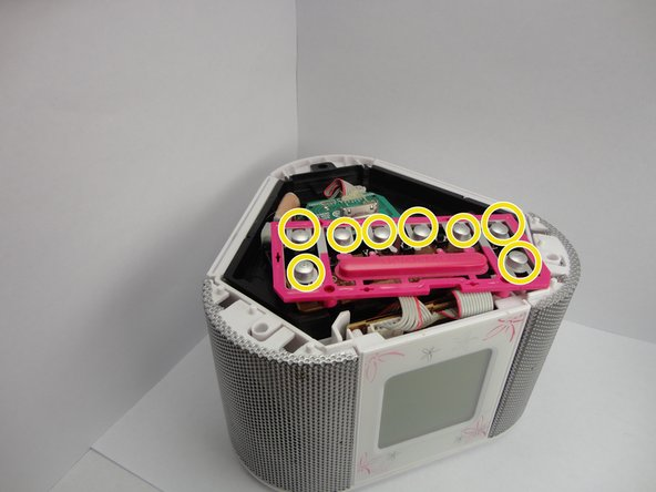 Image 1/2: Then align the pink button sheet onto the black circuit sheet.