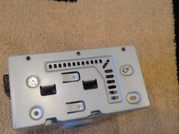 Remove the 2 phillips head screws on the hard drive bay.