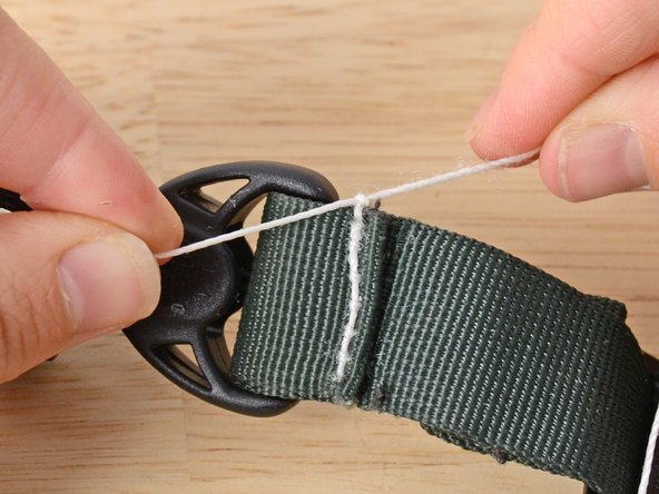 Image 2/2: Tie another knot or two to secure the stitching.
