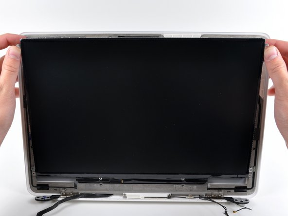 Image 1/1: Do not try to remove the LCD yet. The circuitry along its lower edge is wedged in a gap along the lower edge of the display recess in the plastic display assembly.