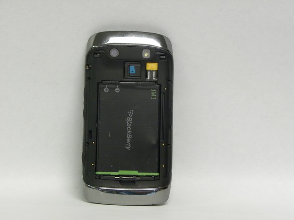 Align the plus and minus signs at the top of the battery compartment with the plus and minus signs at the top of the battery.