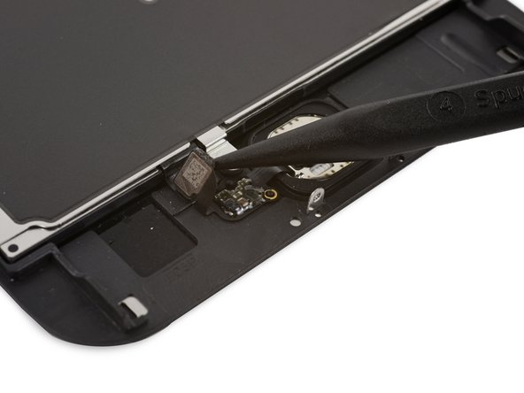 Use the pointed tip of a spudger to disconnect the home button cable from its connector on the display assembly.