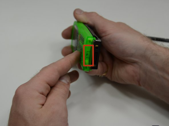 Image 1/3: Using the tip of your fingernail or a spudger, pry the cover away from the rest of the phone.