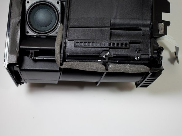 Remove the speakers from their housings, making sure to be careful with the wires.