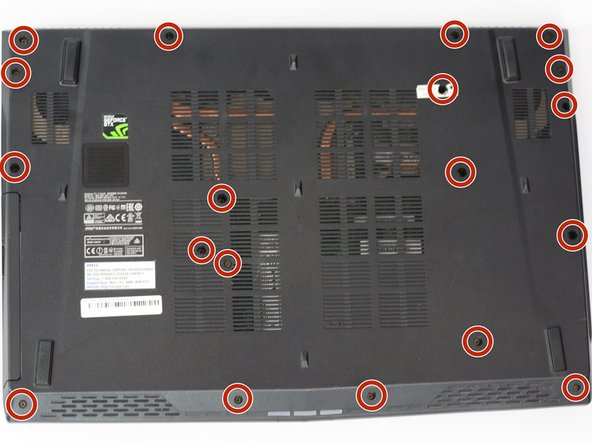 First, take your Phillips head screw driver and begin removing the 19 screws on the back cover of the laptop.