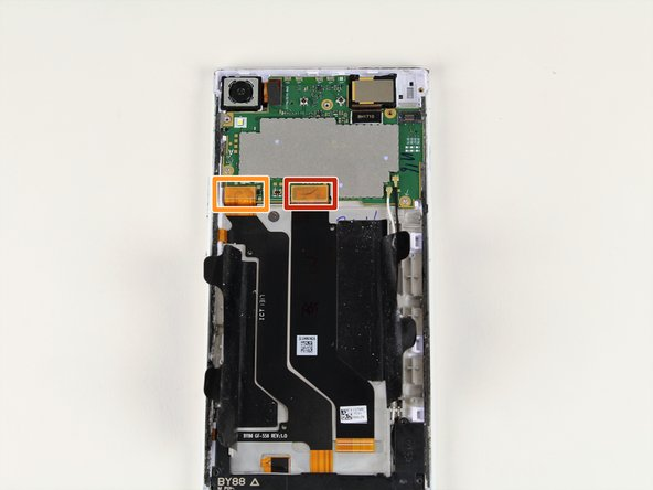 Use your iFixit Opening Tool to remove the main flex (the middle orange tab) from the motherboard.