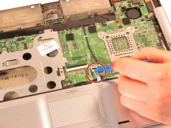 Disconnect the wire from the system board using the plastic opening tool.