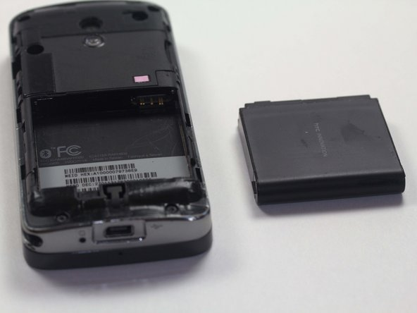 Image 2/2: Pinching the battery, lift up at an angle from the bottom of the phone.