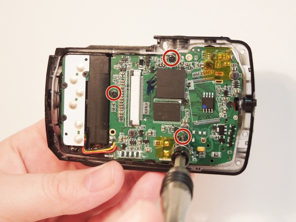 Remove three screws holding the motherboard into the casing using the PH00 bit screwdriver