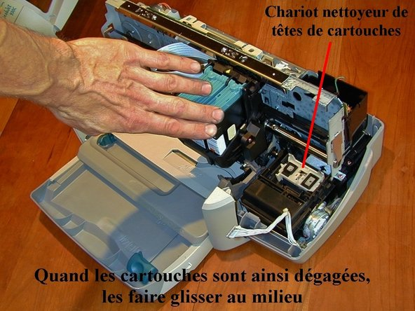 With the motor unplugged, move the ink cartridge carrier to the middle of the printer.