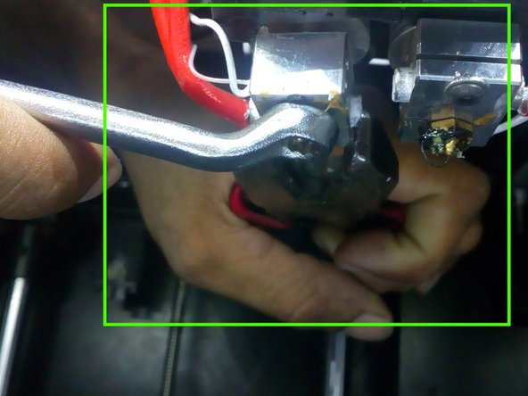 And try to clean the nozzle from the top with the help of a needle and a nose plier.