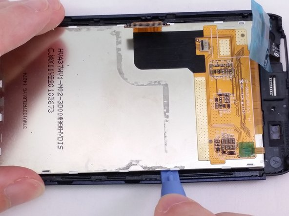 Insert a plastic opening tool between LCD and Digitizer screen.