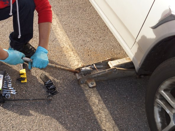 Place the hydraulic jack back under the car and lift it off the cinder blocks or jack stands.