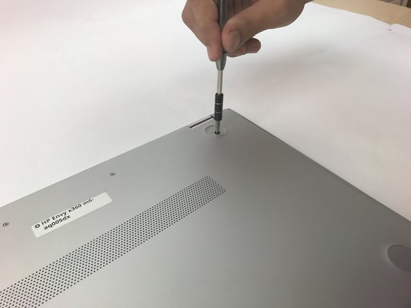 Use a JIS J1 to remove the two 7.2mm screws.
