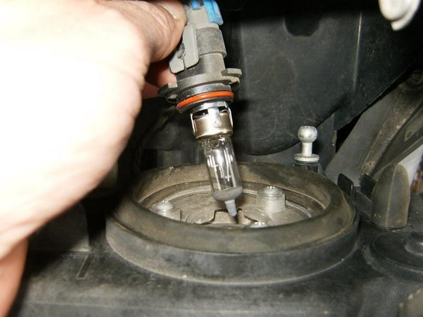 Remove the bulb by twisting it in a counter clockwise direction, then pulling it out of the headlight assembly.