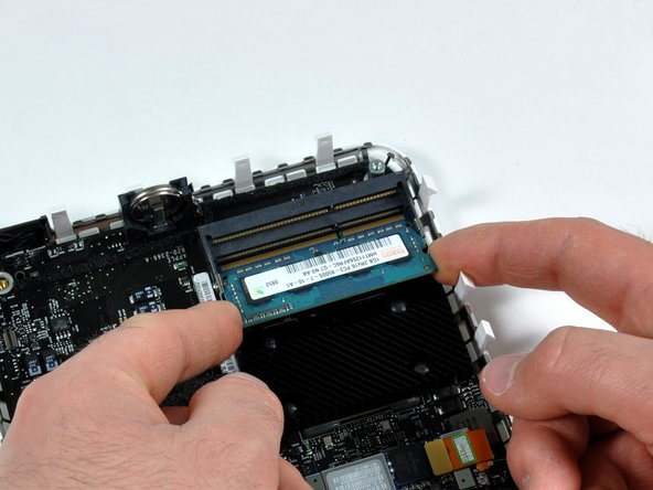 Image 2/2: Pull the RAM chip directly out from its connector.