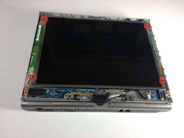 Remove the four 5 mm screws with a Phillips #1 screwdriver, each located at the four corners of the screen.