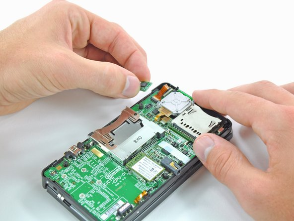 Grab the edges of the IR board with two fingers and lift if from the motherboard.