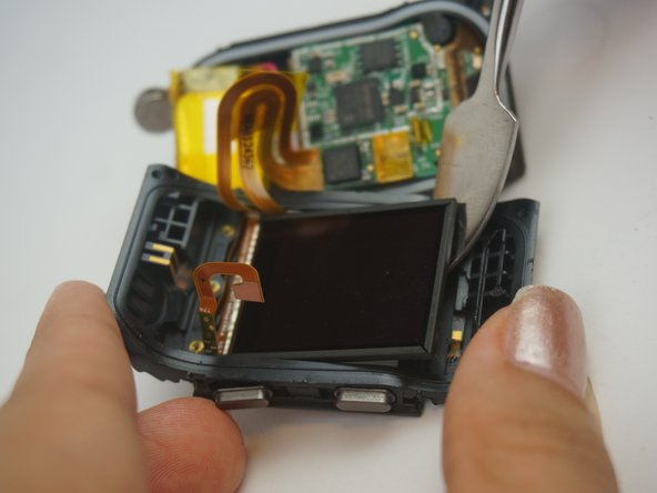 Remove the LCD screen from the clock face.