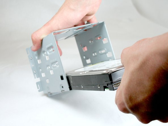 Remove the hard drive from the hard drive cage by pulling it outward from the cage