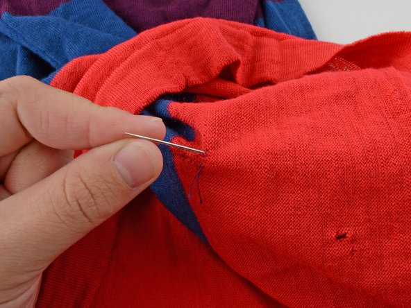 Pull the needle through to the backside (inside) of the garment.