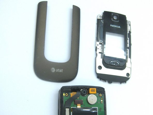 Using a T-5 screw driver, unscrew the screws on the four corners of the phone.