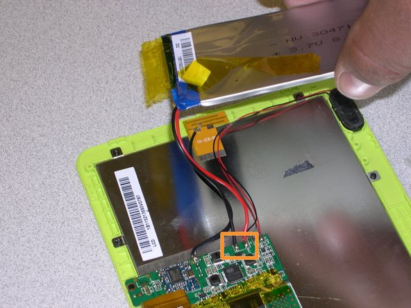 Once you have entirely separated the battery from the back of the display, it will still be attached to the circuit board by the power cables.