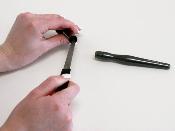 Remove excess glue on the handle and the base of the brush using a nail file.