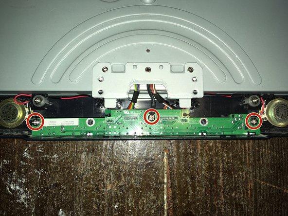 Remove the three Phillips #2 screws.