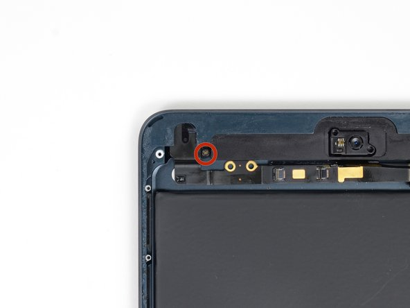 Image 1/1: Remove the single 4.4 mm Phillips screw securing the headphone jack to the rear case.