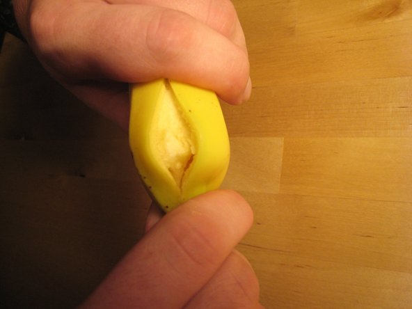 Pull the stem downward until the peel splits.
