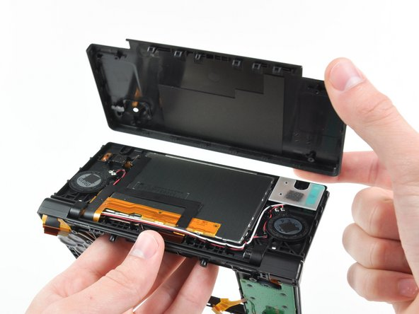 Lift the rear bezel straight up out of the DSi.