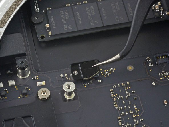 Remove the SATA cable connector bracket.