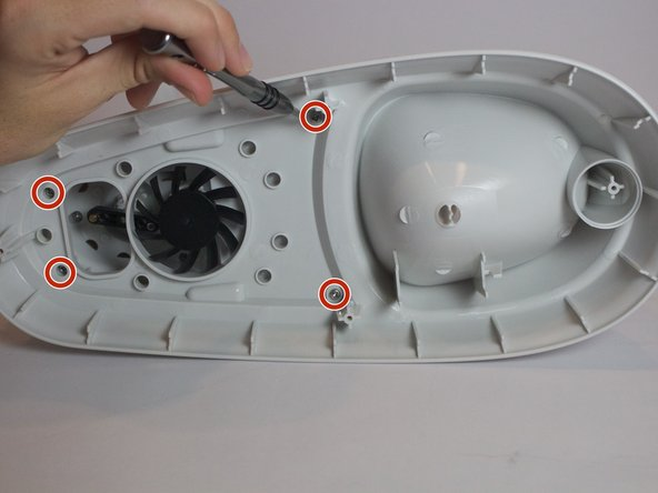 Remove the four 0.8cm screws inside the case located near the fan using the J1 screw bit.