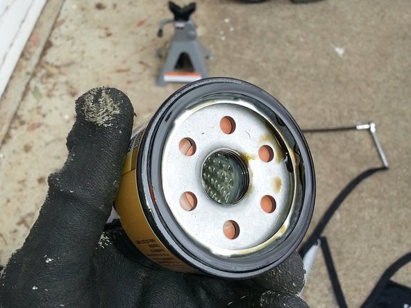 Place a small amount of oil on the o-ring and threads of the new filter make it easier to remove in the future.