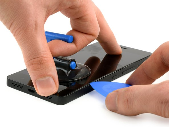 Place a suction cup on the bottom-middle part of the screen and lift it up.