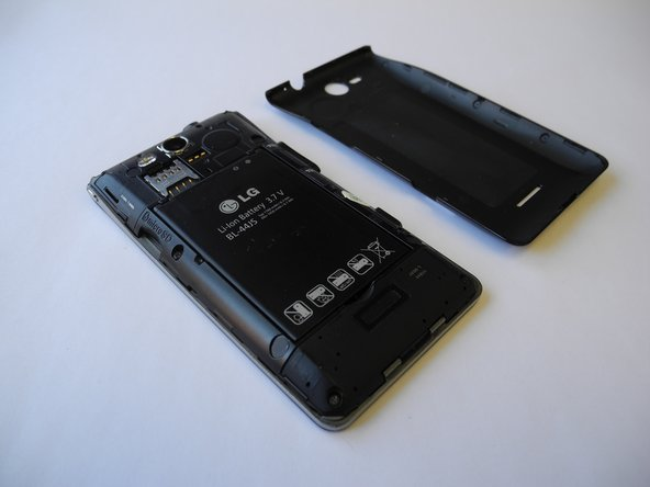 Use your fingernail or prying tool to lift the back plate of the phone open by using the notch at the bottom.