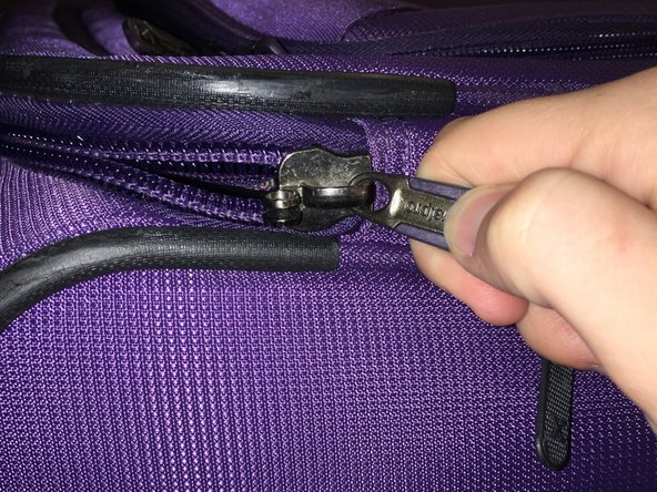Secure the new zipper, using the pliers, setting the stoppers back in place and molding it back together.
