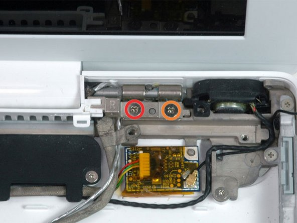 Image 1/1: Remove the following 2 screws from the right hinge mount: