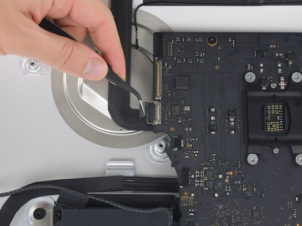 Pull the FaceTime camera cable straight out of its socket on the logic board.
