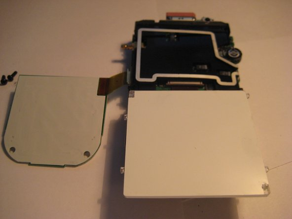 Image 1/3: Pivot the wire frame, that was under the LCD, from the left side.