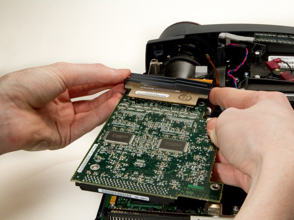 Image 1/2: Gently pry the large ribbon cable connector from the DLP board, and remove the board.