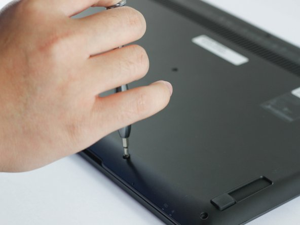 Locate and remove all 12 Phillips #00 6mm screws on the backside of the laptop.