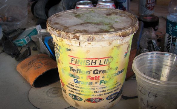 Bucket of bike repair lube at Burning man