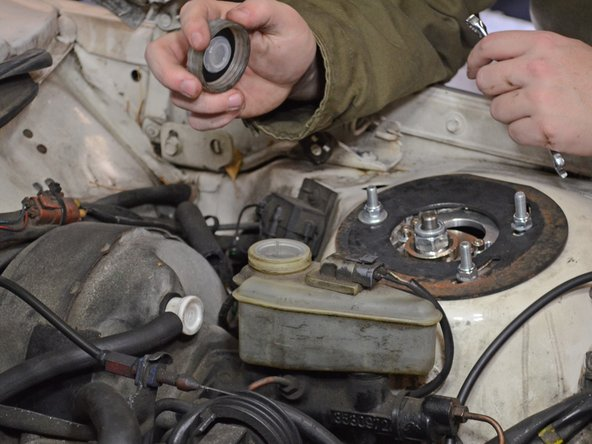 Remove as much brake fluid from the reservoir as possible by sticking a clean rag inside the reservoir.