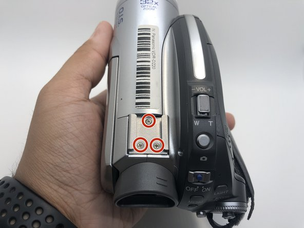 Use your Phillips #0 screwdriver to remove the three 5mm screws on top of the camera.
