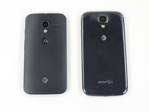 Image 2/3: Since we tend to have a lot of devices laying around, we might as well do some comparisons! The Moto X is certainly not small, but it is a bit smaller than the S4, and we are fans of the contoured back.